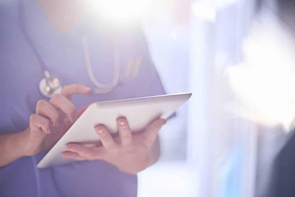doctor using ipad