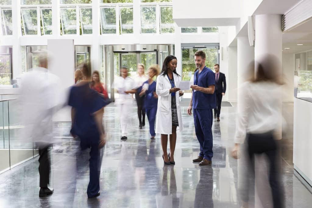 Staff-In-Busy-Lobby-Area-Of-Modern-Hospital-600073876_2124x1416-1024x683 (1)