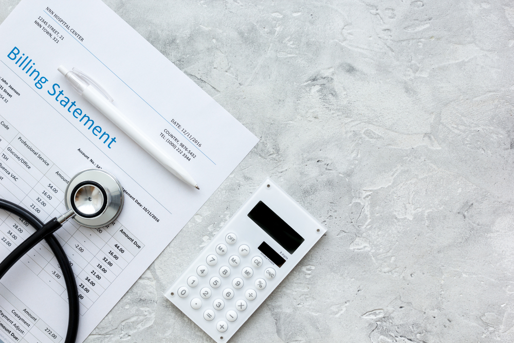 Stethoscope,,Billing,Statement,For,Doctor's,Work,Stone,Background,Top,View