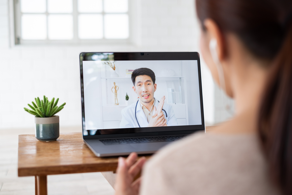 Asian,Woman,Talking,With,Doctor,Via,Computer,Laptop,Virtual,Video